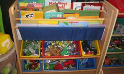 Childrens toy organizer with book sling (3 slots & 6 bins) Has been in son's toyroom but we are re-organizing and changing around. Paid over $50 - letting go for $30 Can meet in west end of ottawa (kanata) or constance bay