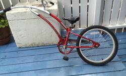 Red Trail-a-bike to attach to your bike, making it easier to bike with your young children, aged 4-8 approximately.