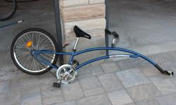 Attaches to adult's bike to be able to bike together at an adult pace. Great for longer rides. Includes all parts. Some rust on pedals, and one handgrip could use replacement, overall in good working order.