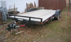 Trailer for sale    Car hauler 18ft by 7  Dual axle  Bought new in fall of 09, used about 8 times, just don't need it anymore.  Comes with new spare tire, not shown, side stake pockets, and hidden ramps on rear right side.  Also have tie-down chains that