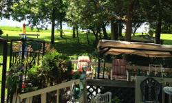 Travel trailer for sale on beautiful lot on Whitelake overlooking water at Whitelake RV Park. Nice big deck. Great beach! Boat dock rentals available. Lot fees paid until the end of 2015! Lots of extras....2 sheds with tools, paddle boat, picnic table,