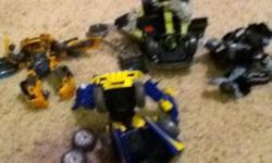 I have bumble bee, ironhide with turret, ratchet hummer. Buy 2 get the twin and mini optimus prime free. $20 for everything. wolverine is sold. bumble bee pic not shown. every transformer is from episode 2