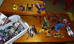 A whole bunch of Transformers.  A couple come with manuals.  I bought this off Kijiji, but I'm not Transformer-Inclined to figure them out and my son isn't showing any interest.  Now, with all the Christmas stuff, they've gotta go. $30 obo