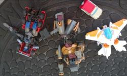 Lot of 4 transformers. $15 for all 4. gently used. If I knew how to put them back together you could see what they are more clearly! LOL. See other ads too. Thanks.