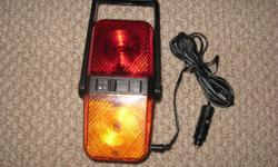 Selling a Travel - Emergency Light. ( Charges in Car Lighter.) 3 different lights - red, yellow and neon. * Handle can be moved into different positions.* You can hold it in your hand, or stand it up. ( Perfect size - not big and bulky.) ** Great for