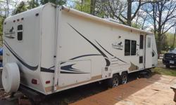 2006 Travel Trailer Palomino Thoroughbred 26.5 foot, Model T265 Trailer comes fully loaded: - 12 foot Slide out (living & kitchen) - 20 foot awning, three roof vents, rubberized roof - Sleeps 5 - Fridge / freezer (electricity and propane), gas stove,