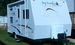 Travel trailer JAYCO, 16 ft. , refrigerator 5 cu ft. 3 burner range with 9,000 BTU and piexo igniter,microware, oven. lightest-weight  travel trailor(2000 pounds) , radio AM/FM/CD, crank-up TV antenna with signal booster. LP/gas leak detector, smoke