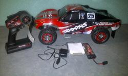 For sale is a Traxxas Slash 4X4 VXL that is in awesome condition as you can see from the pics. The truck comes ready to run with battery, charger and 2.4 radio. There are several brand NEW parts and upgrades on the truck including, new body, new tires and