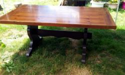 Large trestle table with two leafs. the table is solid wood with veneer. It has minor scratches on the surface. The base has been painted a deep chocolate brown & we were going to carefully strip the table top & stain it the same colour, However, my