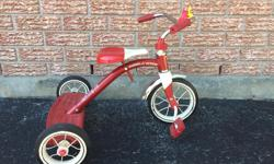 Metal and rubber trike in great condition.