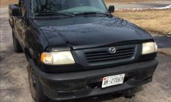 "Make Mazda Model B-Series Pickup Year 1998 Colour Black kms 277000 Trans Automatic Selling ""as is"" Recent improvements include brake lines, battery, ball joint. In good running condition. Asking 850 OBO."