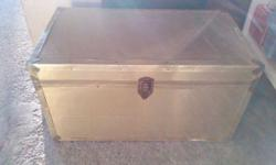 """Large wooden trunk 19""""H x 35 1/2""""W x 19 1/2""""D exterior painted gold, interior could be wallpapered. Good for table with storage or toy box."""