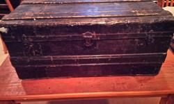 This is an old black trunk with wood inside could be used as a coffee table has neat hasps and wood across top sides etc... Asking $95 Check out my other ads for more interesting items.