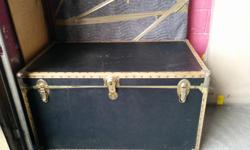 Black lined trunk with gold accents, excellent for storage. 2ft H, 3.7 ft W, 2,1 ft D $75 or best offer