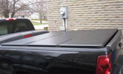 Hard top folding tunneau cover, like new. Fits 4 door. $1700 new, selling for $800. Please call 705.792.2930.