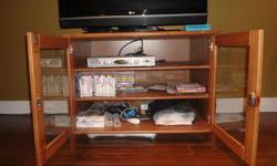 Pine Ikea TV Cabinet with 3 shelves and 2 glass doors. Has small pry mark on front trim. Good working condition.