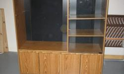 Wooden TV ENTERTAINMENT UNIT in excellent condition for sale.  Room for your TV on the one side and DVD, PVR, Cable Box, etc. on the glass enclosed shelves on the other side.  Storage underneath with wood doors to keep CD's, DVD's, etc.  The unit is on