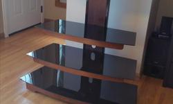 """I have a tv mount with glass shelfs in like new condition It is, 48"""" hight, 40"""" width and 19"""" deep Please text me if you are interested 306-515-3557 serious buyers please. Thank you!"""