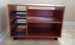 """TV Stand on casters In excellent condition: no scratches or defects. Dimensions: 29.5"""" or 75cm L 17"""" or 44 cm W 20.5"""" or 52 cm H Buyer must pick up"""