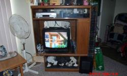 TV unit with 2 glass door shelves. It holds a 26 in tv approx