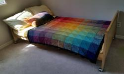 """In excellent condition. 77"""" long, 42"""" wide. Includes mattress and brand new sheet set."""