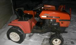 """Two 1976 Ariens tractors. Hydrostatic tractor has 48"""" snowblower attachment, PTO driven, hydraulic lift. Also has rear hydraulic lift. Selling both tractors together. They have cast iron Kohler engines. The second tractor is a gear driven tractor and also"""