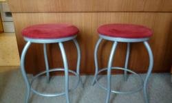 "Two large Bar Stools excellent condition, hardly used. Red swede seat covering with grey steel legs. 24""h, 16"" dia.seat. Original price $200ea. Reduced for quick sale $65 ea.   Call : 767-4645"