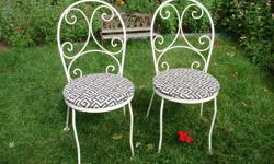 Two wrought iron bistro chairs,as is,still solid just need repainting. 55