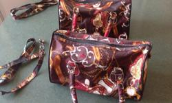 Two attractive carrying cases. Women's size 1 or 2 Henselite bowls. Has shoulder straps included also.