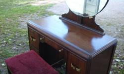 REDUCED PRICE Set of 3 items. High boy dresser, vanity dresser and stool. Looking to sell asap. Mirror is a bit damaged in the bottom. On the back it says walnut veneer but very solid inside. I believe the handles are originals.