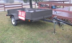 Located in Elliot Lake 4x8 trailer. Light wieght,tilts and tows great.3 good tires and folding leg on tongue. $650 obo   2x3 enclosed atv,ski doo,or motorcycle trailer. Light weight but solid construction. Comes with a set of bolt on skis.$650 obo Just