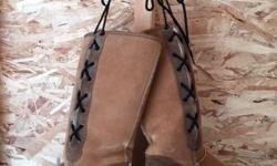UGG BOOTS PURCHASED IN AUSTRALIA LACE UP ALONG THE OUTSIDE NEVER BEEN WORN SIZE 9 PLEASE TEXT FOR DETAILS