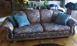 This contemporary multi-colored sofa (raspberry, teal, gold, purple) with a purple large chair will make a perfect addition to any cottage, student apartment or renting a furnished apartment bringing a sense of comfort and style. Both sofa and chair have