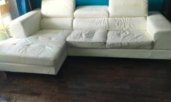 Very well used Couch for sale Downtown. Price is negotiable. You must be able to pick up the couch. The couch is bonded white leather, there is craking on two of the cushions. Seats are worn in as it is 5 years old. Would rather find it a new home than