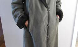 Women's fully lined winter coat with attached hood by Utex Design. This coat comes from a pet free, smoke free home and was only worn a few times, it is in perfect, like new condition. Faux fur collar, liner and adjustable cuffs. Soft to the touch outer