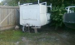 this trailer is an old 1500 dodge that has been converted to a trailer the frame axle and wheel bearins are all in great shape   it has inclosed storage in the front an open  6 foot box with ladder racks would be a roofers dream come check it out im