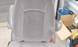 2 Van Bucket Seats with cup holders no idea what kind of vehicle they came out of maybe the pictures will help message me for details