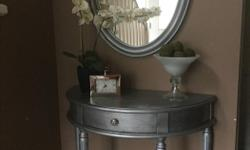 Can be either an entrance table or vanity . Painted silver , with unique decoupage on top , black glaze as accent . Protected and sealed with polycrylic. Wood pieces but not solid wood. One centre drawer. Cute crystal knob. Table is 36W x 17D x 32.5 H