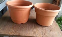 """Various planters for sale: 1 - 9"""" x 13"""" (wide) - terra cotta colour - $4.00 1 - 10"""" x 13"""" - terra cotta colour - $4.00 1 - 10 x 13"""" - taupe colour - $5.00 1 - 12"""" x 14""""- terra cotta colour - $5.00 1 - 11"""" x 13"""" - square - taupe - $6.00"""
