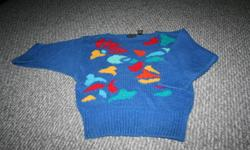 Various sweaters that range in size from small to large and price $1-$3   blue knit size medium $2 yellow hand knit sweater $2 size small Ricki's size small short sleeve $3 Handknit navy very heavy size medium $3 Red size medium $3 striped sweater short
