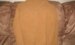 Various sweaters for sale.  Excellent condition.  Extra large and large sizes.  Most purchased from Cotton Ginny.  Rarely worn.
