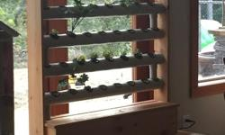 Vertical garden made from western cedar from a small company in Victoria (www.verticalorganicgarden.com). Was only used for a few months last summer. It can be used indoors, but was designed to sit on a patio/porch. I paid $829+tax. This model is the
