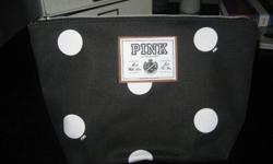 Large polka dot VS Pink makeup bag black with white polka dots, pink, plastic lining Never been used 403 877 7517- text or leave a voicemail