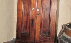 Walnut wood - not veneer. Mid-19th Century. English - Probably originally in a tobacconist-type shop in London. I have used it mainly on floor as small end table or accent piece that is useful to store small items. (Back piece needs small repair to fix on