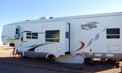 2006 Victory Lane 39 ft toy hauler in mint shape. Used very little. 12 ft Garage c/w extra overhead cabinet storage. Interior in very good shape with slide in main living room kitchen area and slide in bedroom. Queen bed. Also has overhead loft above
