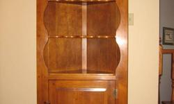 """VILAS MAPLE CORNER CUPBOARD   Solid Vilas Maple Corner Cupboard in great condition.  The top finial was broken off years ago and only lightly glued it once so it is still in perfect condition to reglue properly. About 75"""" tall, 30 """" wide and 20"""" deep."""