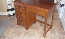 Solid maple 4 drawer students desk.  Very good condition.  Made in Canada by Vilas.  $100.00 OBO.  Port Dover for pick up.