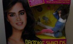 I am selling a Vintage 1982 BROOKE SHIELDS doll from LJN, NEW YORK. This box set includes: A star shaped ring from BROOKE, plus a doll brush, posing stand and an AUTOGRAPHED PHOTO! The box has never been opened and it still has it's original price tag of