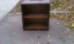 this cookcase does need refinishing or a coat of paint it is still very solid has a small chip out of the bottom , and i do mean small the top has a slit in it and on the next shelf down their is a top ledge part which has pins there so on sure they could