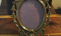 A brass picture frame that is beautifully detailed. It is in very good condition. Asking $10 call 7786765557. Check out my other ads.